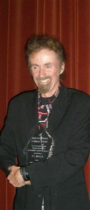 T.C. Boyle with his Ross MacDonald Award.