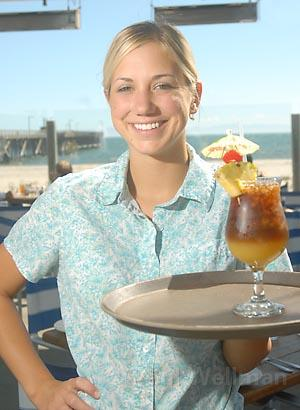 Beachside Bar-Cafe server Trisha DeWaard serves up food and drink with a smile at the readers' choice for best Goleta restaurant