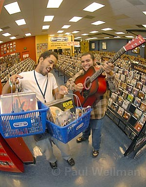 Robbie Crew (left) and Dave Esquer showcase the wide selection available at Morninglory Music.