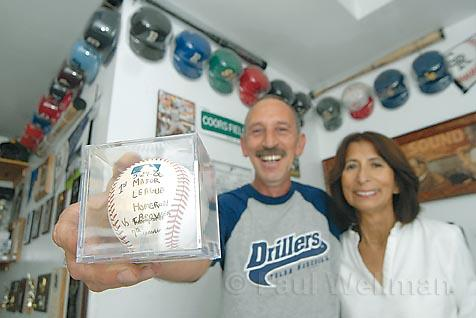 Rene and Essie Spilborghs have filled their son's old room with baseball memorabilia showcasing caps of all the teams Ryan played for, collectable bats, and scores of game baseballs, such as this one from Ryan's first MLB home run.
