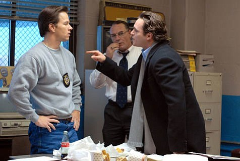 Like fashion, fall brings us movies with layers. <em>We Own the Night</em>, starring Mark Wahlberg (left) and Joaquin Phoenix, mixes police and Russian mafia dissonance with family discord, all shot with a gritty beauty.