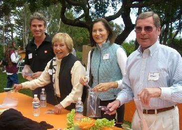 Thomas Tighe, Judy Cresap, Elisa Atwill, and Bob Cresap filling dental health packages.