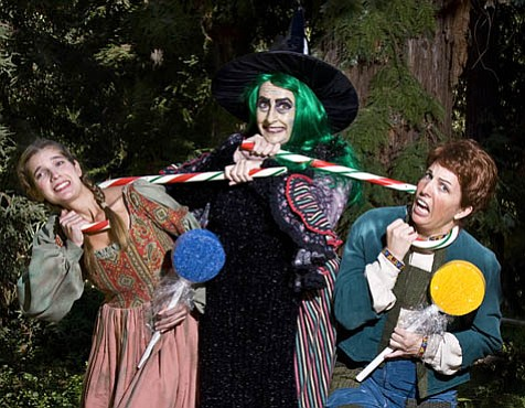 Sarah Viola as Gretel and Sarah Campbell as Hansel are candy-cane lassoed by Teresa Brown as the Witch in Opera Santa Barbara's <em>Hansel and Gretel</em>.