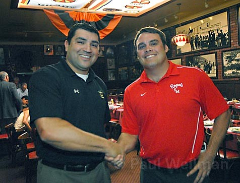 Santa Barbara High coach Will Gonzales (left) and San Marcos coach Dare Holdren shake hands at the Athletic Round Table luncheon. They'll be meeting on the football field this Friday for The Big Game.
