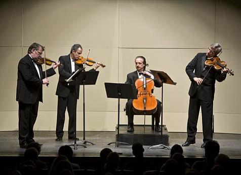 The Emerson Quartet is, from left: Philip Setzer and Eugene Drucker, violins; David Finckel, cello; and Lawrence Dutton, viola.