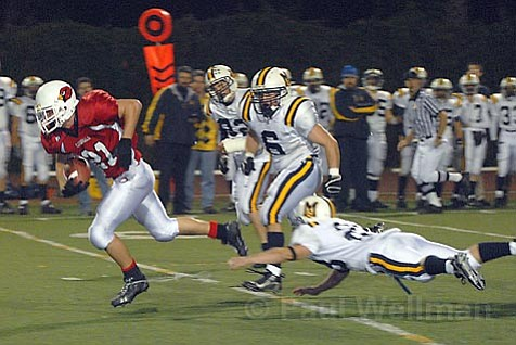 Bishop Diego's Aaron Skinner was slowed down by Mary Star of the Sea's Joseph Ponce in the Cardinals' 36-0 victory over the visiting San Pedro team on their warpath to the division championships.