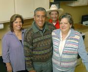 From left: Volunteers Teresa Lopez, Jorge Mu±oz, Jose Lopez, and Yolanda Mu±oz.
