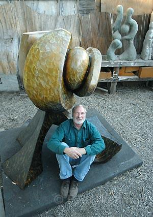 "Sculptor Larry Rankin at his Santa Barbara studio with one of his works, ""Sedona Sunset."""
