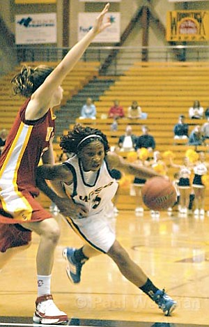 UCSB's Chisa Ononiwu drives to the basket in a recent home game for the Gauchos.