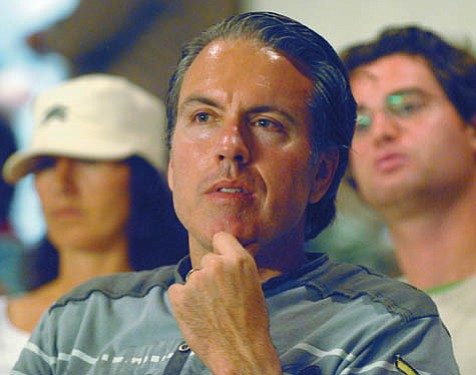 Things are heating up for both Orange County developer Matt Osgood (pictured) and those opposed to dozens of luxury homes being built at Naples