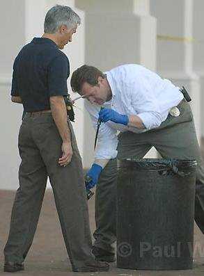 Detectives find knife in trash can.