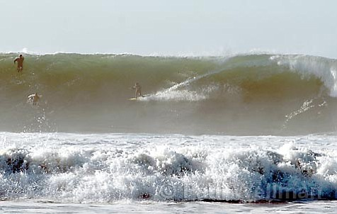 A waverider races a big one in the river mouth section at Rincon early Wednesday morning.