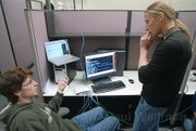 Giovanni Vigna (right) discusses possible hacking strategies with one of his computer programming students during a hacking competition in December 2007.