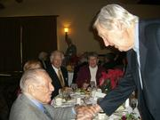 Fess Parker (right) shakes the hand of Art Linkletter at the Channel City Club event last week.