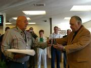 Herb McElwee (left) presents comedian Jonathan Winters with an award from the Wildland Firefighters Foundation for the actor's entertaining help during the Zaca Fire.