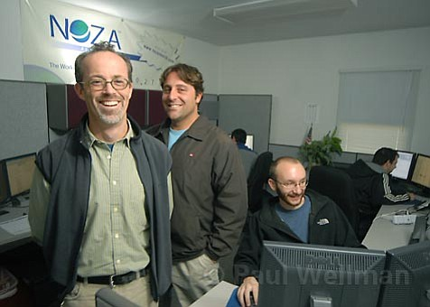 "Nonprofit visionary and UCSB grad Craig Harris (center) founded Noza to help charities across America ""raise more money, and spend less doing it."" To do so, he's employed the help of friends like Vice President David Ruehlman (left) to develop Web-searching technology that's already located and organized more than 28 million donation records."