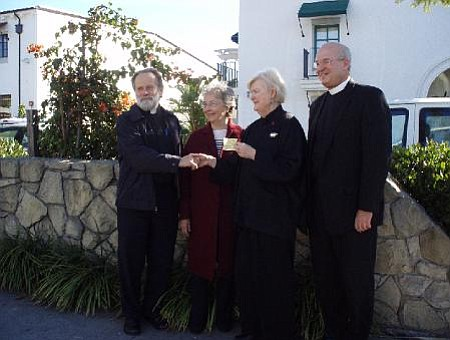 CLUE gives a $5,200 check to help Santa Barbara's Ten Year Plan to End Chronic Homelessness hire an executive director.