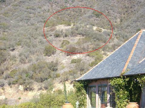 The site of the proposed Largura residence, with story poles visible within the red circle.