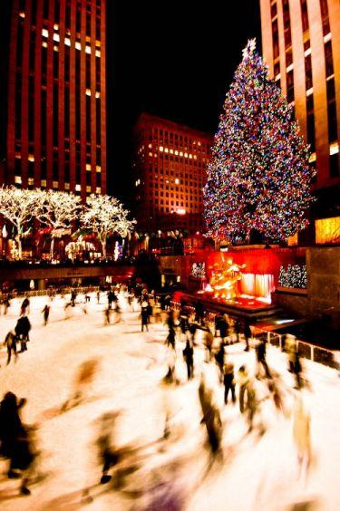 Ice skaters at Rockafeller Center enjoying the rink near the huge Christmas tree, sans snow.