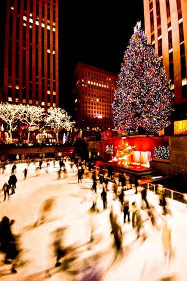 Ice skaters at Rockafeller Center enjoying the rink near the huge Christmas tree, sans snow.