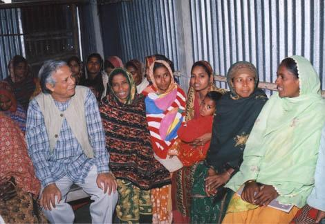Professor Muhammad Yunus talks with some of Grameen Bank's borrowers at a meeting. Of Grameen's 7.34 million borrowers, 97 percent are women