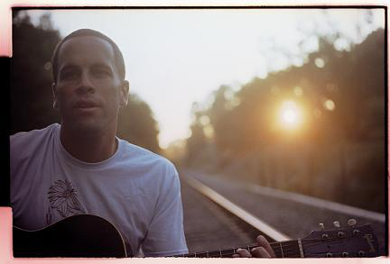 Jack Johnson on railroad tracks near his home in Montecito.