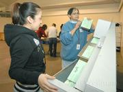 Julie Plaza (left) and Delores Lugo process absentee ballots arriving at the Earl Warren Showgrounds from Santa Barbara North County. 
