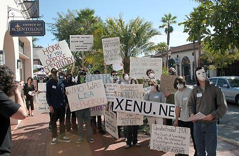 About 30 people, most all wearing masks to hide their faces, gathered in Santa Barbara on Sunday to protest what they deem inappropriate behavior by the Church of Scientology. The group joined thousands of protests taking place around the world