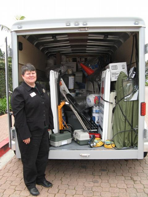 Louise Kolbert, emergency services director at the local Red Cross, shows off contents of the trailer.