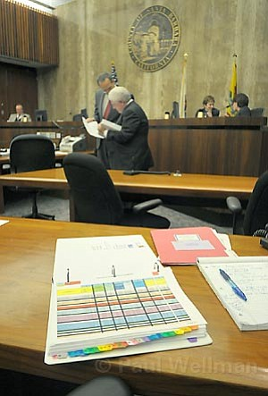 The budget binder is becoming more and more complex with increased deficits this fiscal year for County Chief Mike Brown (front) and his budget guru Jason Stillwell (back).