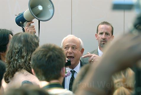 Daniel Morse, UCSB professor of molecular genetics and technology and director of the Army Institute for Collaborative Biotechnologies, soon gave up trying to talk to the crowd of student protesters. At his shoulder is Associate Director Frank Doyle, professor of chemical engineering.