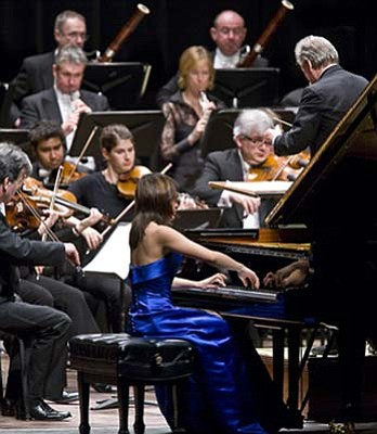 Twenty-one-year-old Yuja Wang played Mozart with Neville Marriner conducting at Wednesday's concert by the Academy of St. Martin in the Fields.