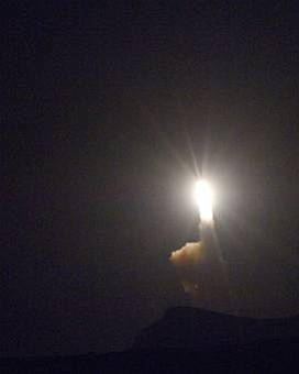 A Minuteman III ICBM launches from a silo at Vandenberg AFB.