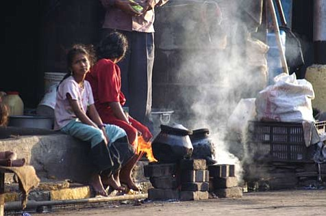 Despite India's 21st-century prosperity, millions of people still live on the streets. This girl, seen cooking her morning meal as the sun rose over Mumbai last February, is just one of the countless faces locked into a seemingly endless cycle of poverty.