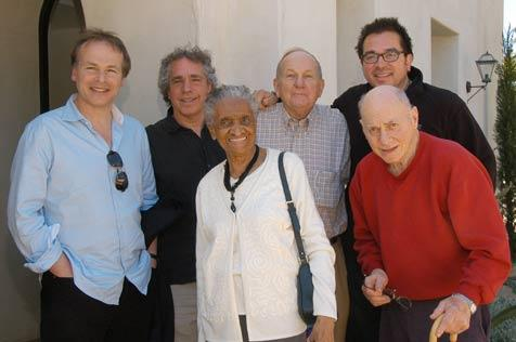 Roger Durling (back right) got together with Bob Cilman, the director of the Massachusetts chorus group Young@Heart (second from left), chorus members, and Stephen Walker, the director of the film about the singers (far left).