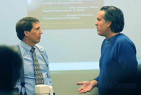 Santa Barbara County Planner Tom Figg (L) and Naples owner Matt Osgood talk at a break in the meeting