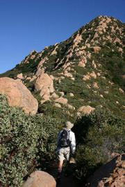 Hiker heads up the spiny ridge to Cathedral Peak. Off trail exploration can be dangerous.