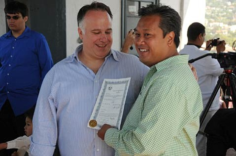 WEDDING BELLS: Newly certificated spouses Ross Bearsdley and Percy Sales.