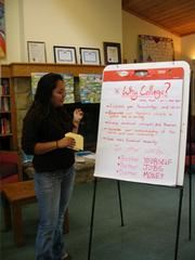 Laguna's Kenya Rodriguez teaches a group of young girls about why they should pursue higher education.