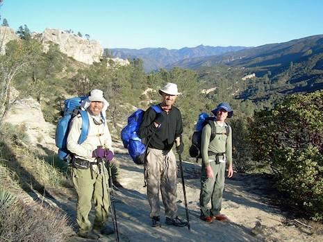 Happy campers like this enjoying the views overlooking White Ledge Canyon in the San Rafael Wilderness are smiling because they got a good night's sleep in their toasty bags.