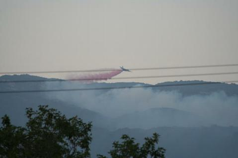 A tanker makes the first drop on the July 1 fire near West Camino Cielo.