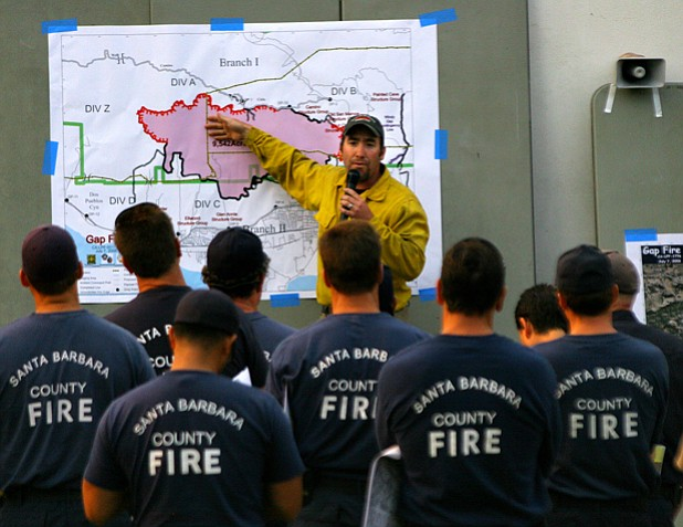 A member of the Unified Incident Command Team briefs fire crews.
