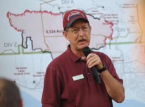 Warren Bennett (pictured) who assumed official control of incident command of the Gap Frie earlier this morning addresses the different fire fighting agencies at Sunday's 6 p.m. meeting,