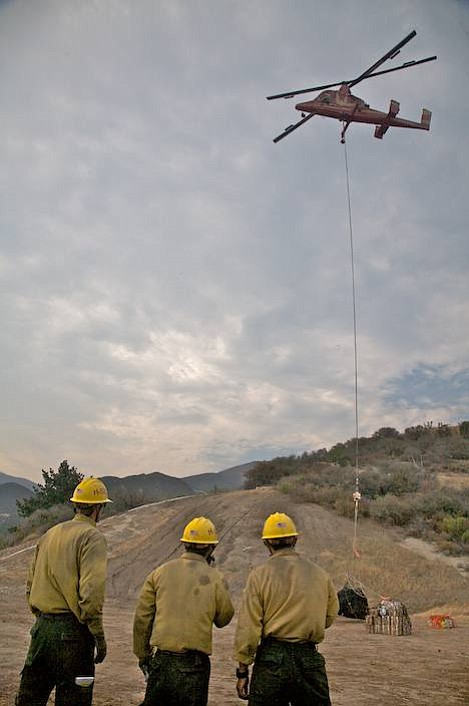 Helitack crew members from Santa Ynez help load gear for the hotshots who are spending the night near Condor Point.