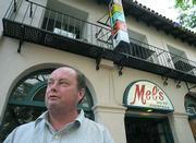 Mel's a.m. employee and p.m. customer John Powers