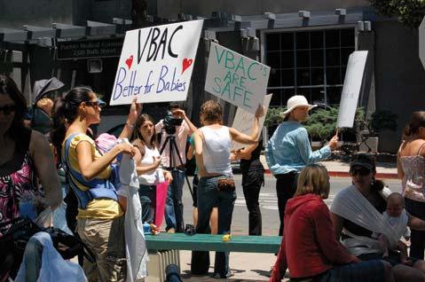 Women, men, and children alike gather outside S.B. Cottage Hospital to protest doctors' choice not to perform VBAC. After the closing of Goleta Valley, Cottage is the only option mothers-to-be have if they want a hospital delivery