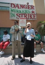 Anne Anderson (right) of Santa Barbara's Clergy and Laity United for Economic Justice (CLUE SB) speaks in support of the strikers