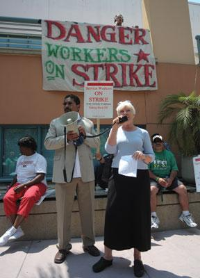 STRIKE SOLIDARITY: Meanwhile, Anne Anderson (right) of Santa Barbara's Clergy and Laity United for Economic Justice speaks in support of the service workers.