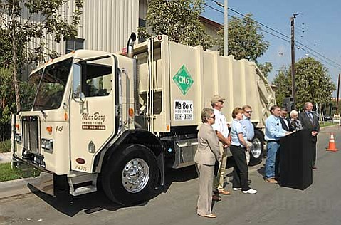 Mario Borgatello introduces Marborg's new natural gas powered trash truck with city and county officials from Santa Barbara and Goleta.