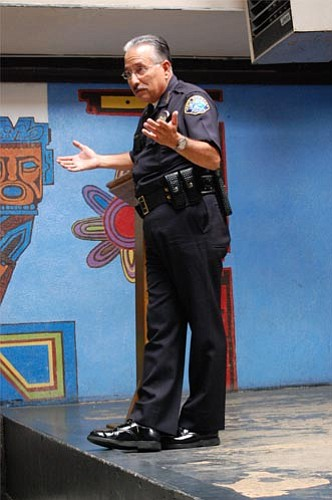 Police Chief Cam Sanchez speaks to youths as Casa de la Raza on the benefits of education.